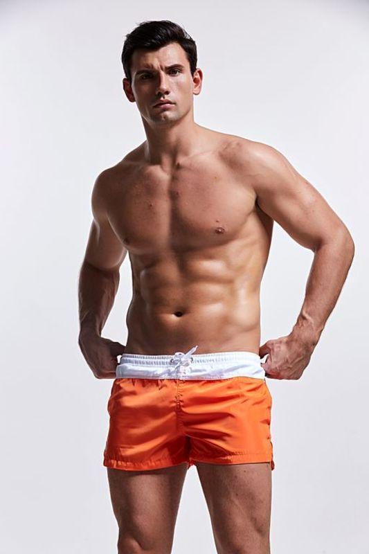 Купальные мужские шорты оранжевого цвета AQUX