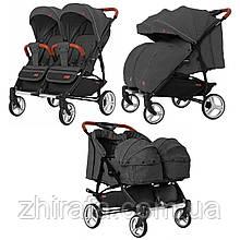 Прогулочная коляска для двойни, близнецов  погодок с люлькой переноской Carrello Connect New Serious Black