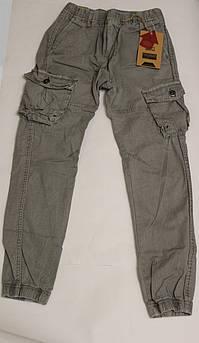 Котоновые штаны с карманами для мальчика серые на манжете Размер 146 см