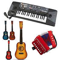 Игрушки. музыкальные инструменты. гитары и гармони
