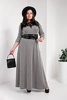 Длинное женское платье с широким поясом под кожу