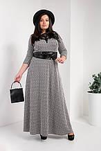 Довге жіноче плаття з широким поясом під шкіру