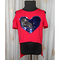 Модный трикотажный костюм с шортами и туникой для девочки