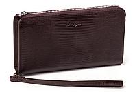 Мужское портмоне - клатч Karya 0709-077 коричневого цвета
