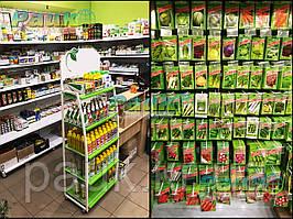 """Стелажі для насіння ТМ """"Рістел"""" від компанії ПАУК в новому садово-городньому магазині."""