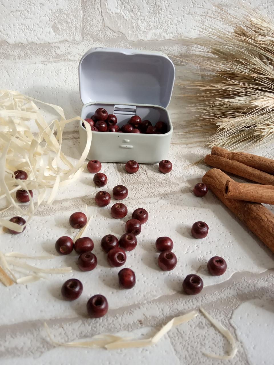 Дерев'яні бусіни вишнево-коричневого кольору, 60 шт,  діаметр - 0,8 см., 15 грн.