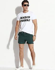 Короткие зеленые шорты