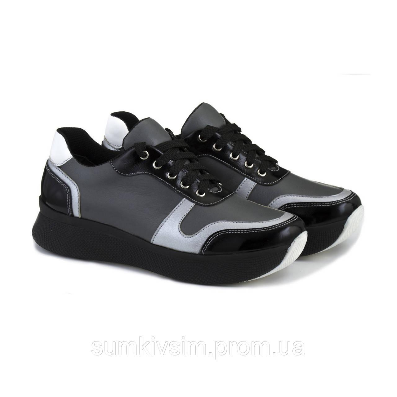Черные кожаные кроссовки на высокой подошве