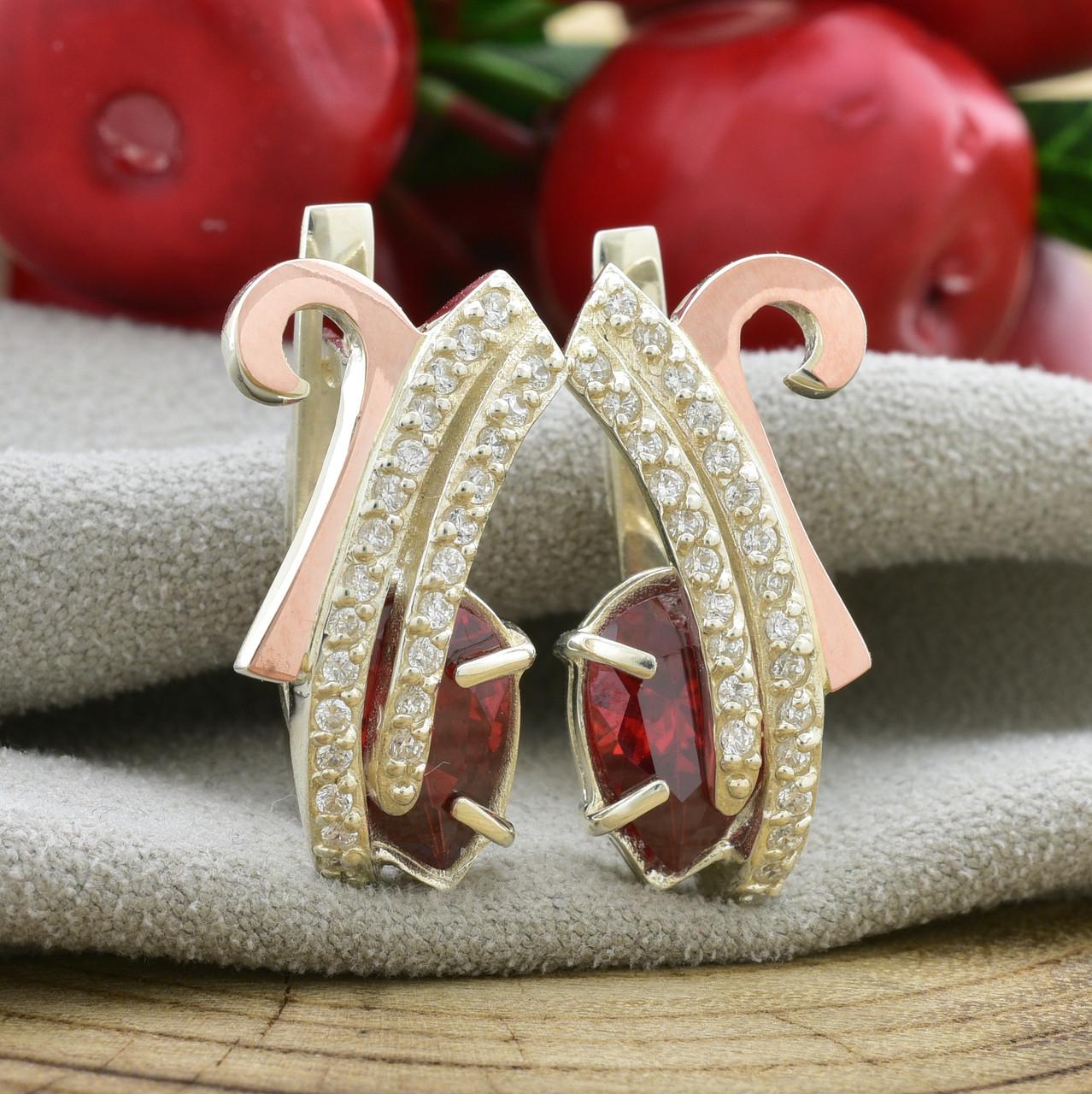 Серебряные серьги с золотом Сильвия размер 24х12 мм вставка красные фианиты вес 8.8 г