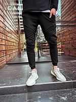 Мужские спортивные штаны черного цвета с манжетом