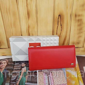 Жіночий шкіряний гаманець на кнопці червоний Prensiti