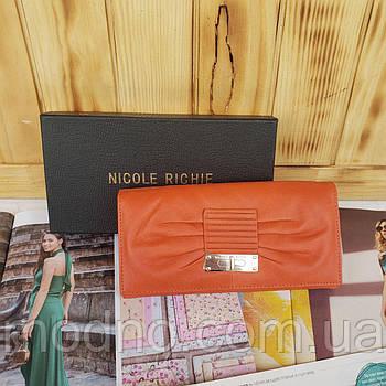 Жіночий шкіряний гаманець на кнопці помаранчевий Nicole Richie
