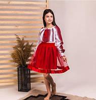Красный чудесный костюмчикдля девочки с юбкой и блузой
