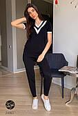 Женский вязаный костюм черного цвета с коротким рукавом. Модель 24907.