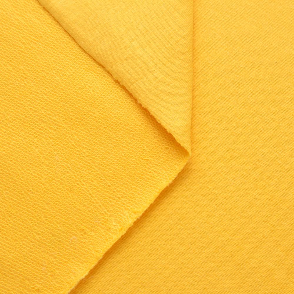 Трикотаж Футер двунитка. Желтый. Купить оптом в Украине, от рулона