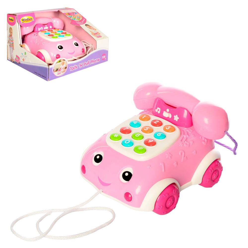 Каталка 0663G-NL  телефон, 17см, на шнурке, муз, зв,св, набат-ке, в кор-ке, 22-14-20см