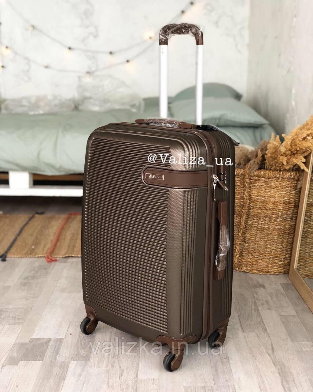 Средний пластиковый чемодан коричневый на 4-х колесах / Середня пластикова валіза