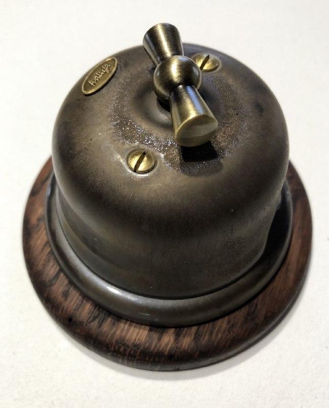 Вимикач поворотного типу 1-клавішний, прохідний, бронза