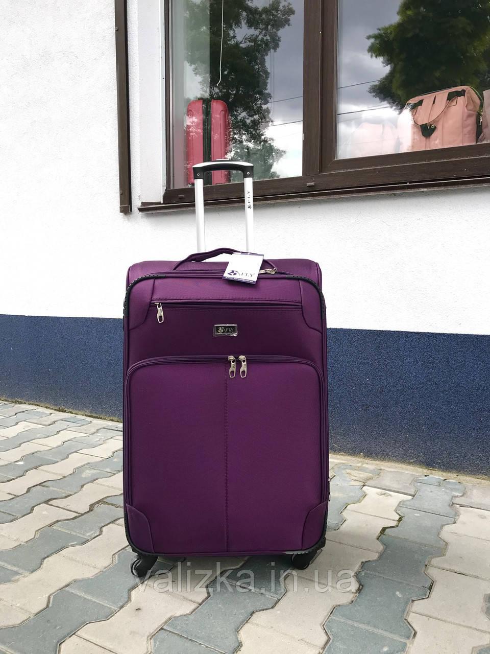 Качественный средний тканевый текстильный чемодан фиолетовый на 4-х колесах Польша