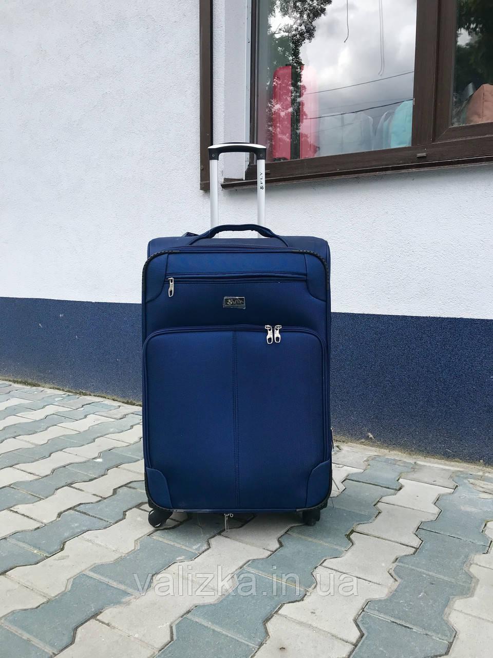 Якісний середній тканинний текстильний валізу синій на 4-х колесах Польща