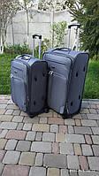 Тканевый чемодан на 4 колеса Fly 1816 серый средний