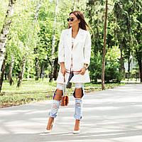 Стильные джинсы с вырезами на коленях 77002