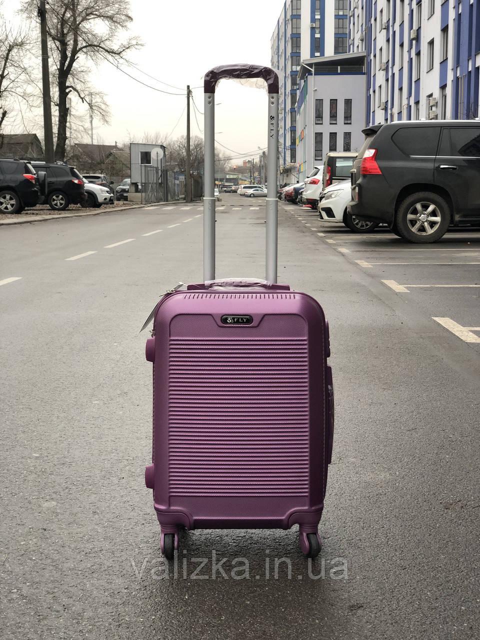 Малий пластиковий чемодан для ручної поклажі на 4-х колесах фіолетовий S+