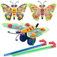 Каталка 305 ( 72 шт/ящ) бабочка - погремушка,на палке, машет крыльями, 3 вида в кульке 27-20-8 см