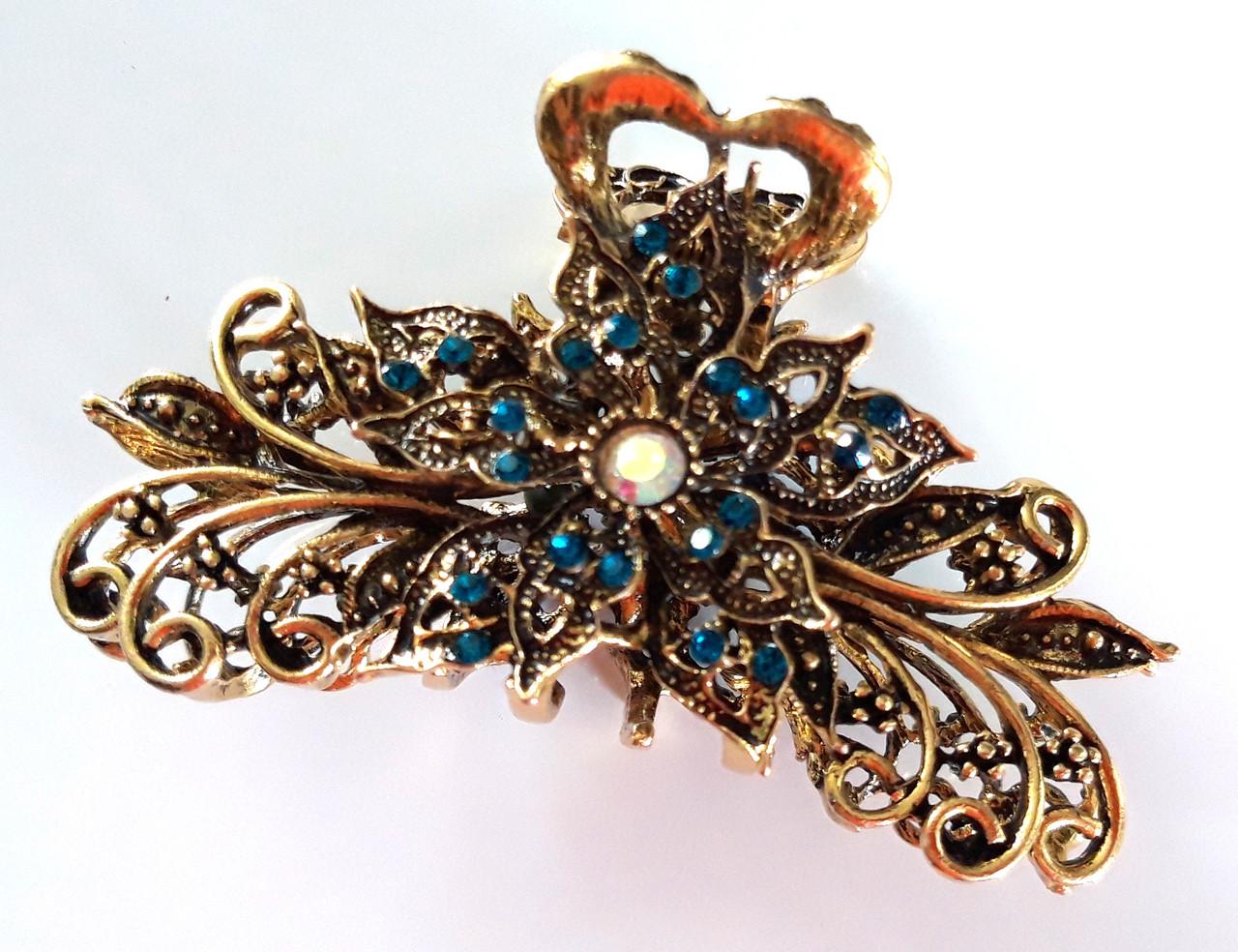 Заколка краб для волос металлический с синими стразами 9х5 см золотистый