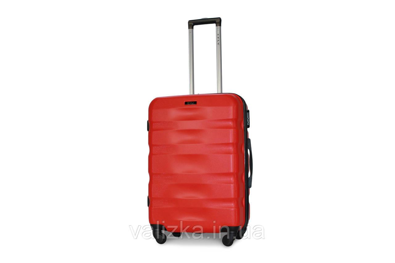 Средний пластиковый чемодан красный Fly 960