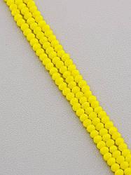 Нитка Чешского хрусталя  желтая длина 44 см диаметр бусин 4 мм
