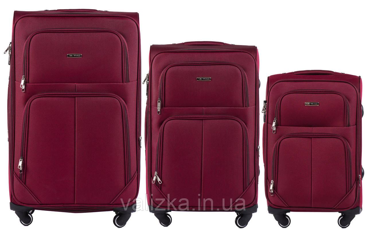 Комплект текстильных чемоданов на 4-х колесах Wings с расширителем, красного цвета