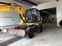 Колесный экскаватор JCB JS 145W 2011 года