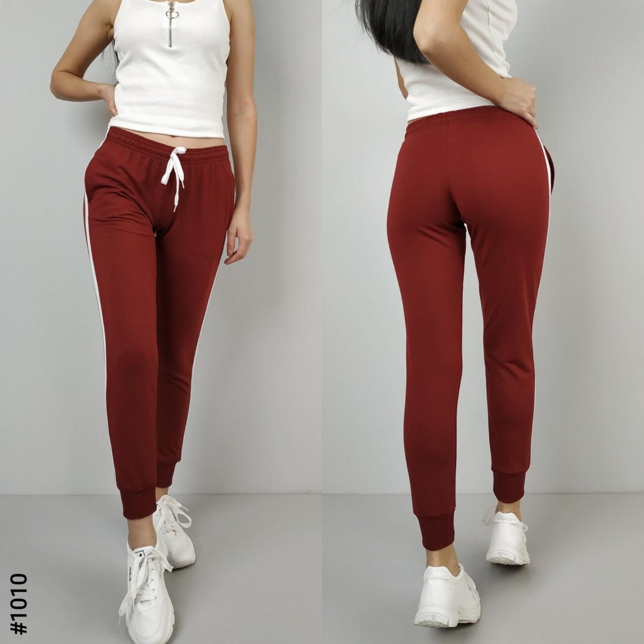 Спортивные женские штаны с тонким лампасом под манжетпроизводство Украина.