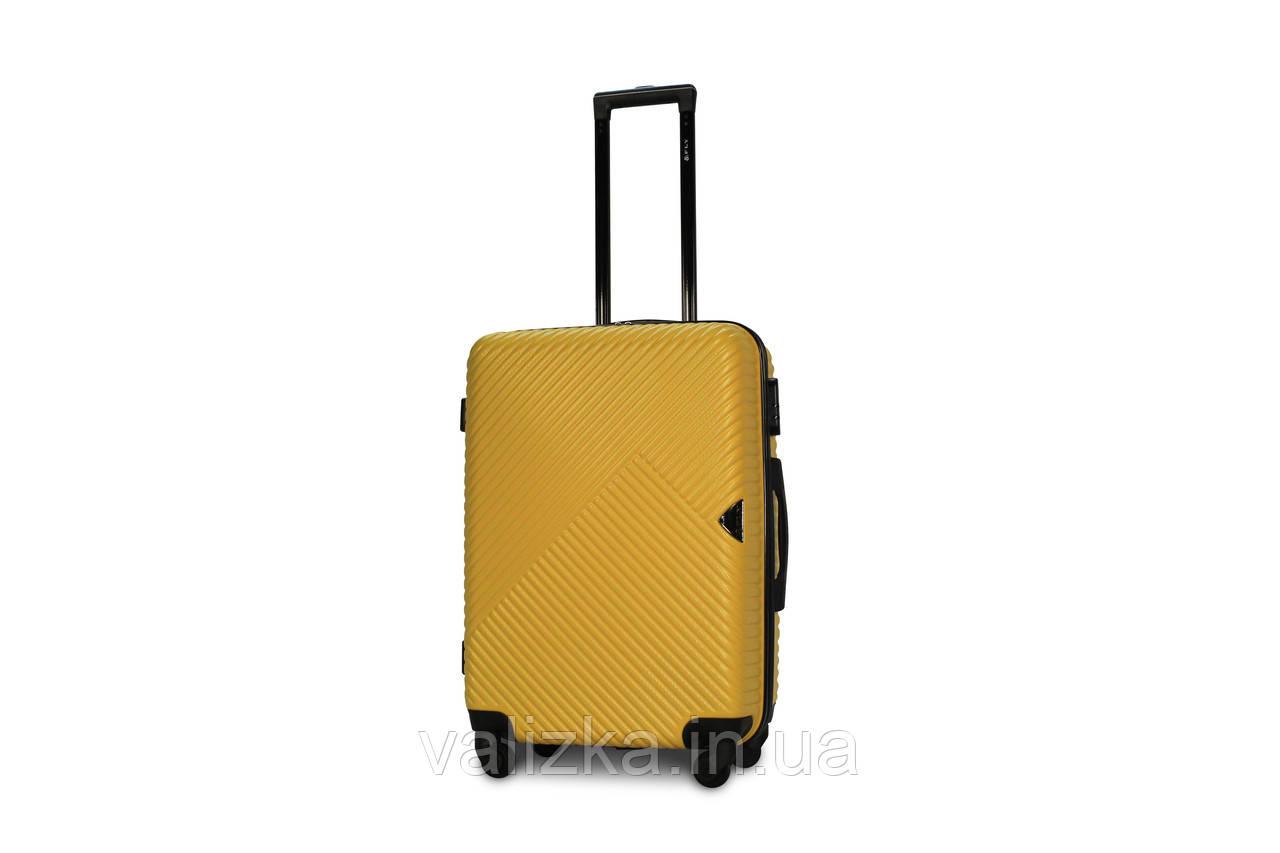 Середній пластиковий чемодан жовтий Fly 2702