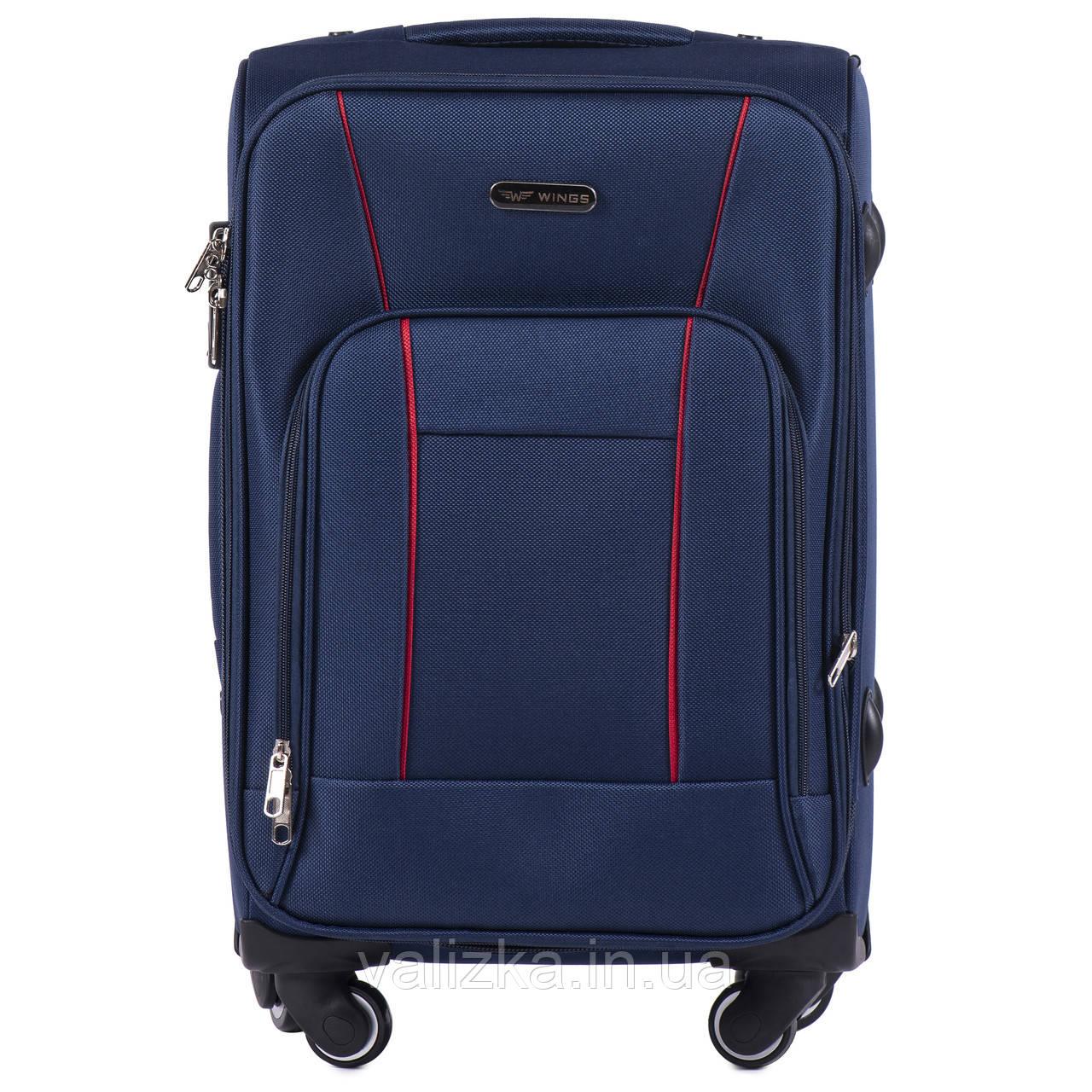 Тканевый чемодан маленький для ручной клади на 4-х колесах Wings 1609 синего цвета