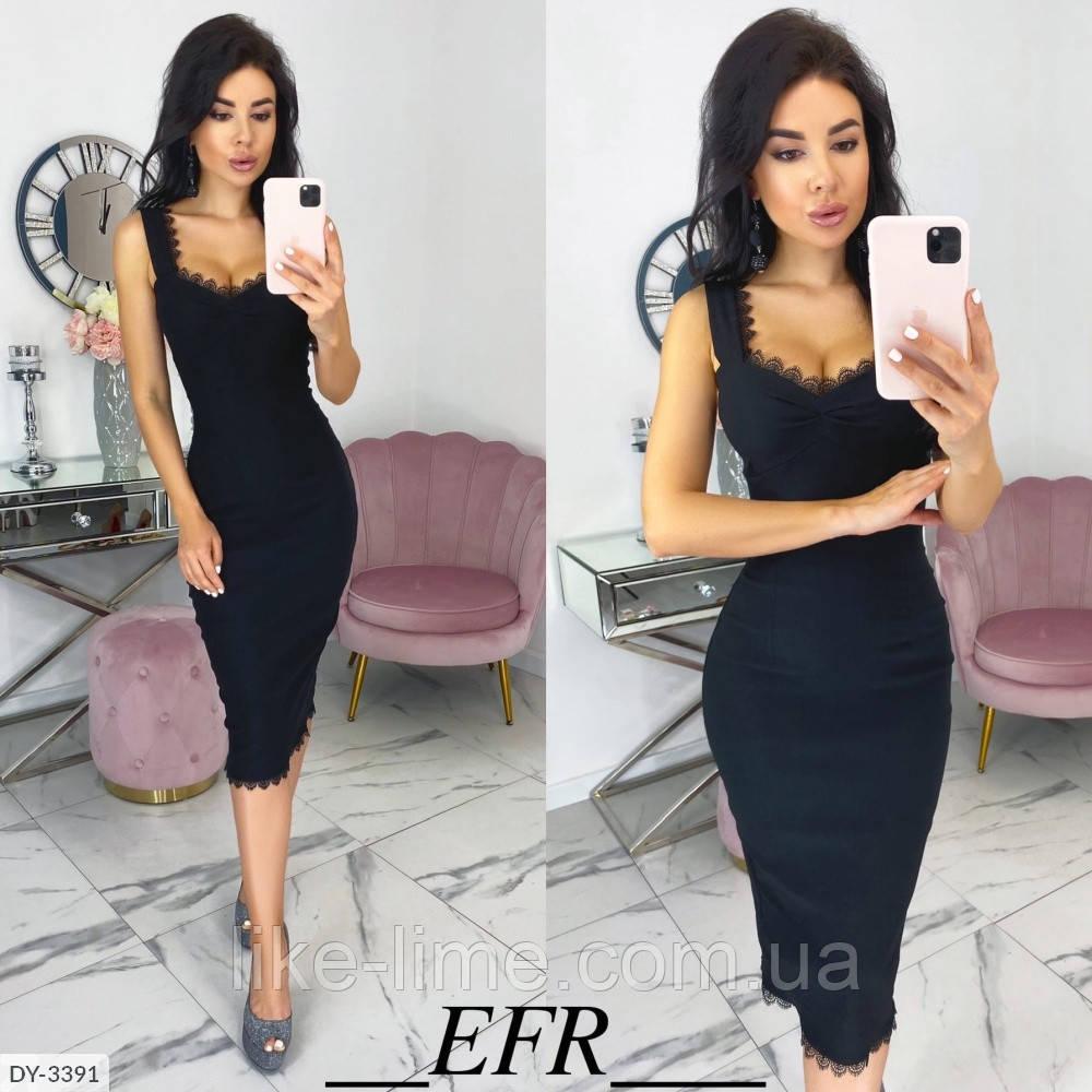 Приталенное женское платье ниже колена