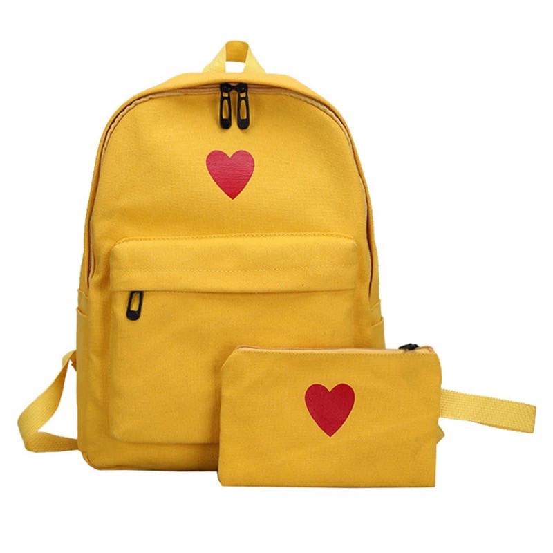 Рюкзак набор для девочки 2 предмета (пенал)с сердечком желтый.