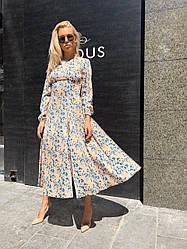 Эффектное шелковое платье миди