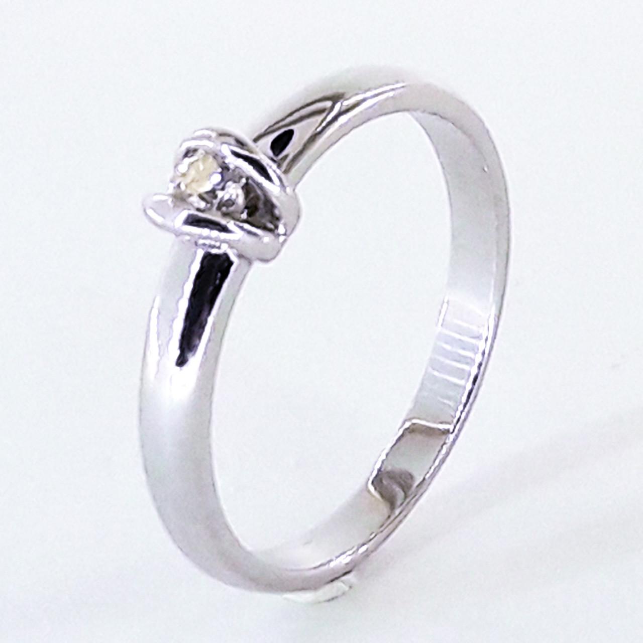 Золоте кільце з діамантом в білому золоті