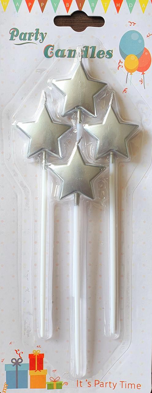 Свечи в торт на палочках в виде серебряных звезд 4 шт