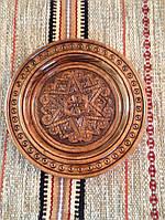 Декоративна різьбленна тарілка ручної роботи