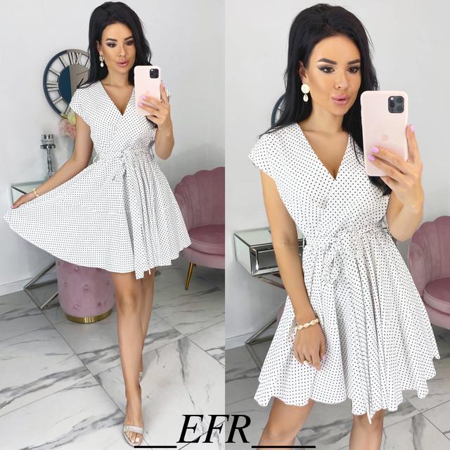 Платье в горошек с расклешенной юбкой