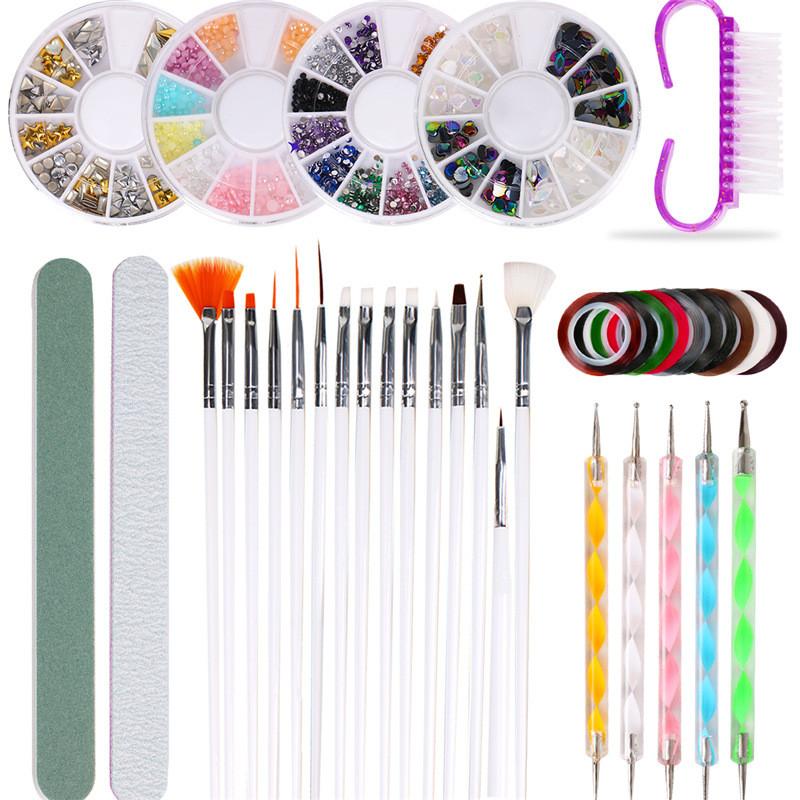 Набір інструментів для дизайну нігтів. Декор для манікюру - пензлики, стрази, дотси, скотч-стрічки, пилочки.