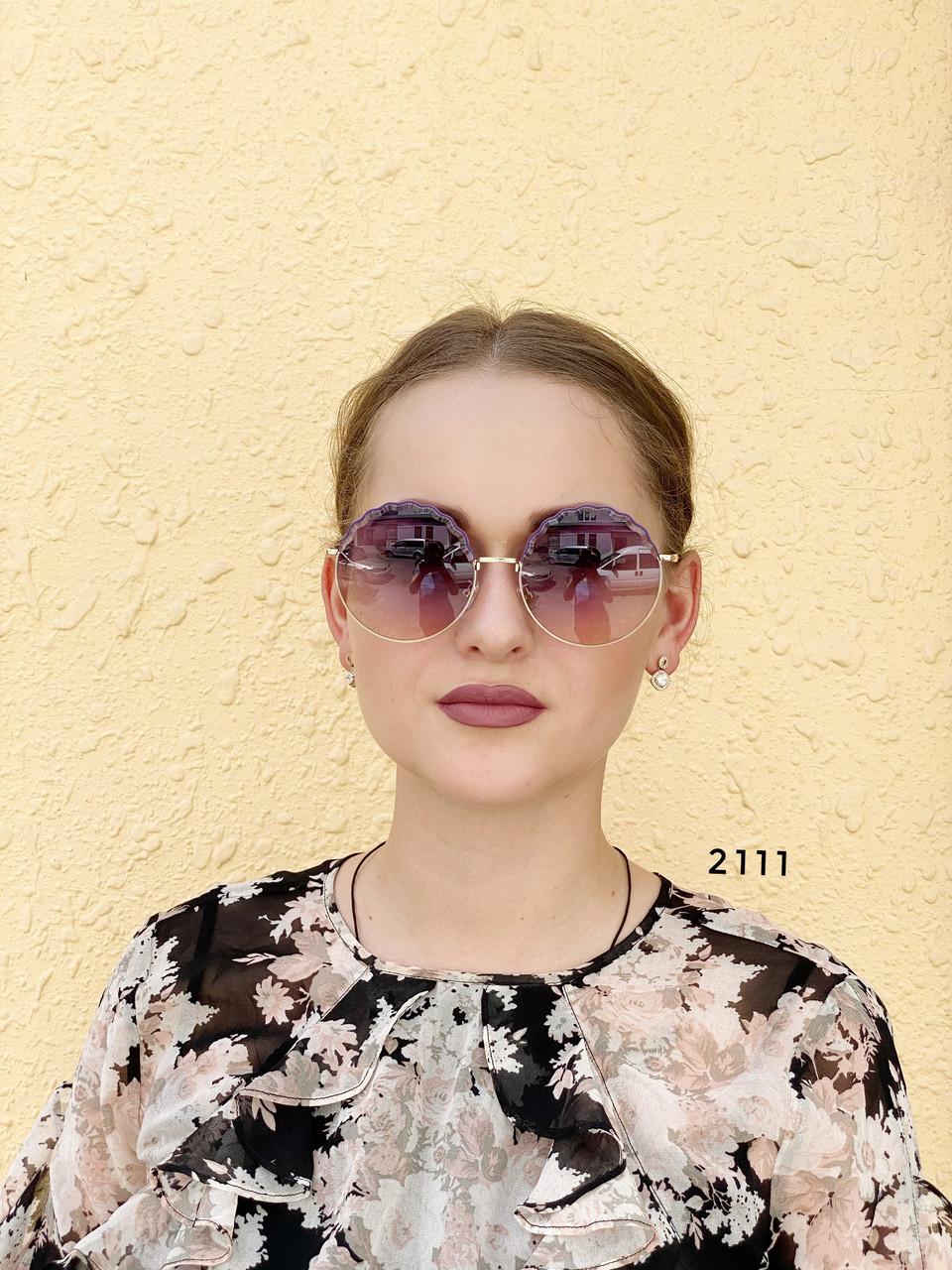 Круглые солнцезащитные очки фиолетовые