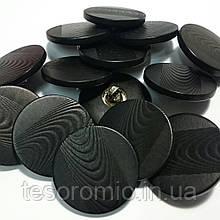 Пуговица пластиковая на металлической ножке, диаметр 2 см, цвет чёрный.