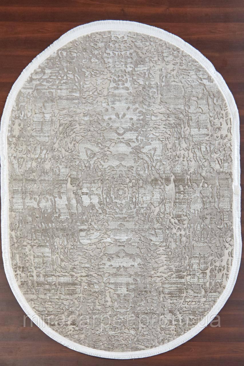 Бежевый овальный ковер, абстракция