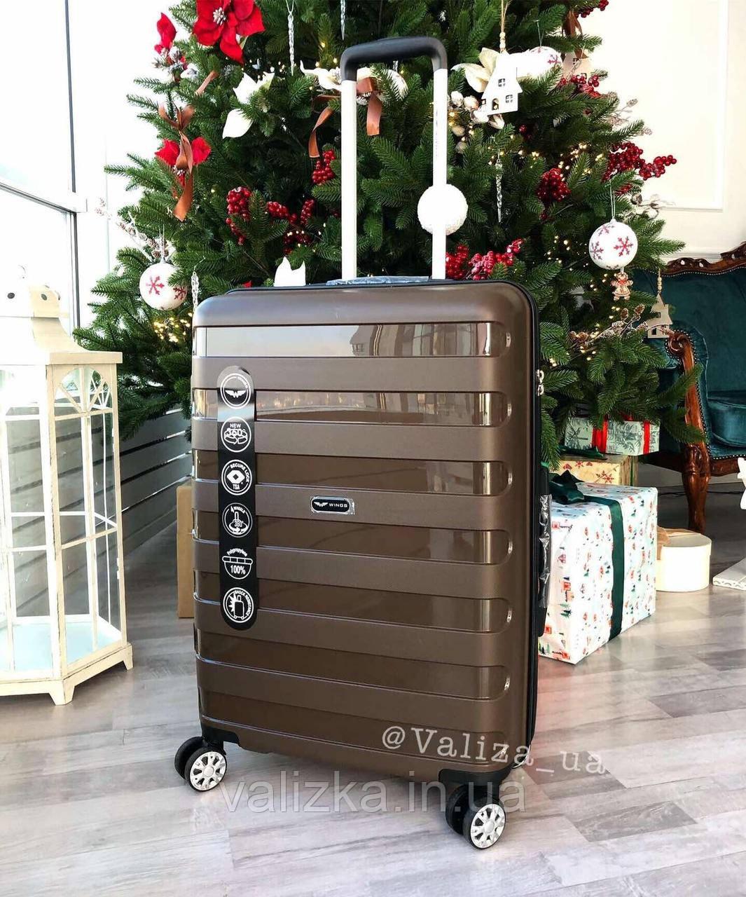 Великий пластиковий чемодан з поліпропілену коричневий