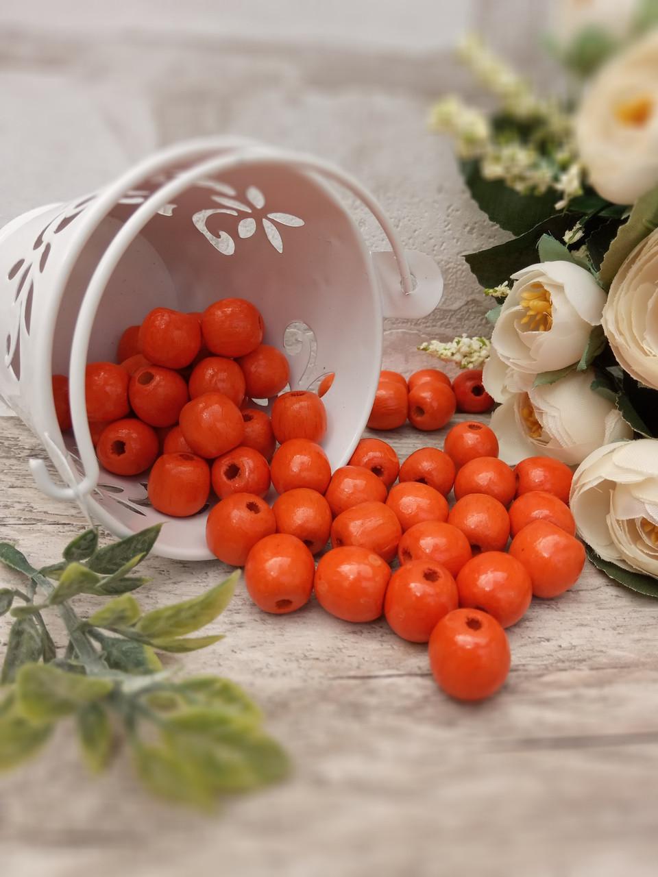 Помаранчеві бусіни з дерева, діаметр 1,3 см, 50 шт/уп 15 грн