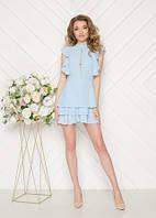 Нарядное платье голубого цвета с воланами
